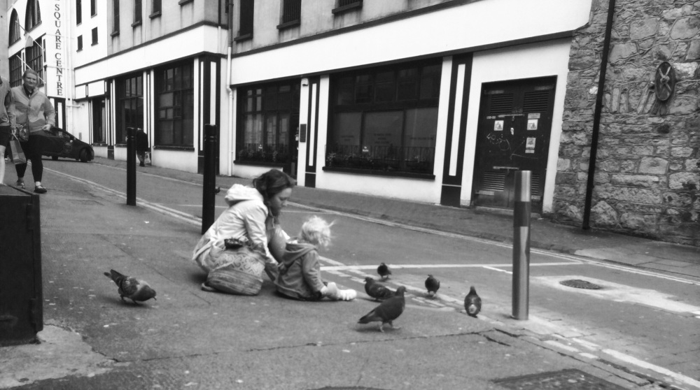 Little Girl Feeding the Pigeons